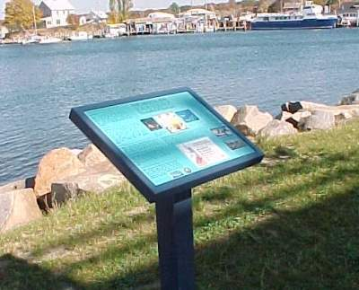 A sign describing the history of the commercial shellfish industry, Cini Memorial Park, East Lyme
