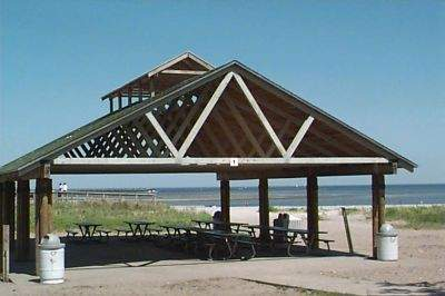 View of pavillion and sandy beach at Short Beach Park, Stratford